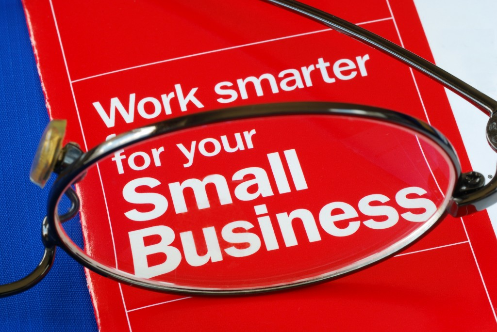 Focus on banking with Small Business isolated on blue