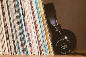 records-on-a-shelf-next-to-headphones